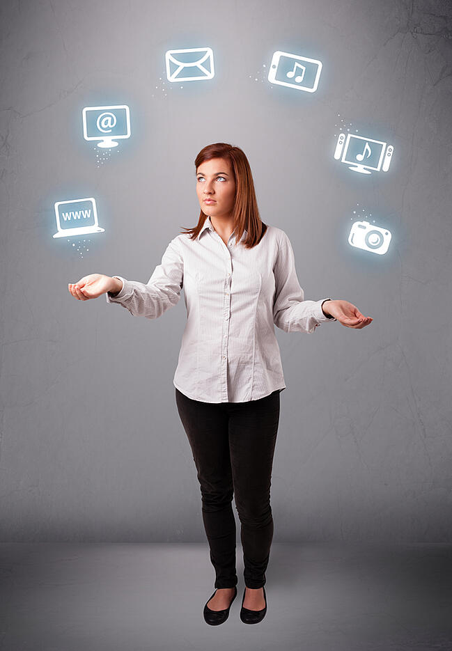 business woman standing and juggling with elecrtonic devices icons